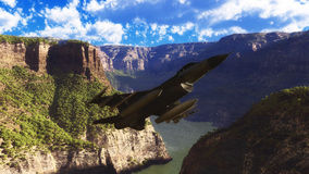 F-16 Fighting Falcon. An F-16 Fighting Falcon flies through a mountain landscape Royalty Free Stock Images