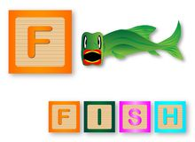 F Is For Fish. Text with sliced apple Royalty Free Stock Photography