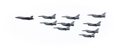 F35 in formation with F16s. F35 flying in formation with F16s on a white background Royalty Free Stock Photos
