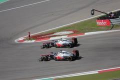 F1 Foto: Formule 1 het overvallen van raceautomclaren Stock Fotografie
