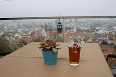The f glass of beer on wooden table on the cafe in Bratislava castle stock photos