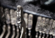 F hammer - old manual typewriter - mystery smoke Royalty Free Stock Photo