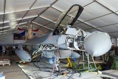 F-16 hangar. VOLKEL, THE NETHERLANDS - JUNE 15: Dutch F-16 in a maintenance hangar at the Dutch Air Force Open Day on June 15, 2013 in Volkel, The Netherlands Royalty Free Stock Photo