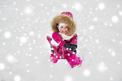 F happy little child or girl with snow in winter Royalty Free Stock Photos