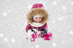 F happy little child or girl with snow in winter Royalty Free Stock Photo