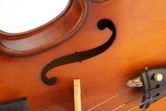F Hole on an old violin. Closed up F Hole on an old violin Royalty Free Stock Photography
