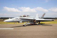 F-18 Hornet Swiss. KLEINE BROGEL, BELGIUM - SEP 13, 2014: Swiss Air Force F/A-18 Hornet on the taxiway of Kleine Brogel airbase Royalty Free Stock Photos