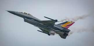 F16 jet aircraft. Belgian F16 fighter jet aircraft with smoke on Stock Photo