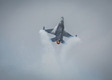 F16 jet. Belgian F16 fighter jet with afterburner and smoke Stock Photography