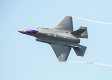 F35 jet. Futuristic USAF F35 fighter jet in flight against blue sky Royalty Free Stock Image