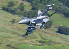 F16 jet. USAF F16 military fighter jet aircraft in flight at apx 600 mph Royalty Free Stock Photos