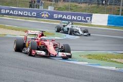 F1: Kimi  Raikkonen, Ferrari and Nico Rosberg, Mercedes Royalty Free Stock Image