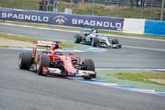 F1: Kimi Raikkonen, Ferrari och Nico Rosberg, Mercedes Royaltyfri Bild