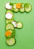 F letter made of raw vegetables Royalty Free Stock Photos