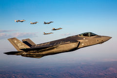 An F-35 Lightning II fighter and other US Air Force jets over NEvada, US. Stock Photo