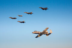 An F-35 Lightning II fighter and other US Air Force jets over NEvada, US. Stock Photography
