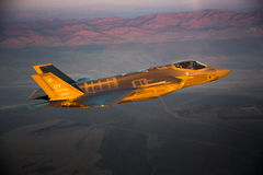 An F-35 Lightning II fighter and other US Air Force jets over NEvada, US. Stock Photos