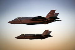 An F-35 Lightning II fighter and other US Air Force jets over NEvada, US. Royalty Free Stock Image