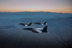 An F-35 Lightning II fighter and other US Air Force jets over NEvada, US. Stock Image