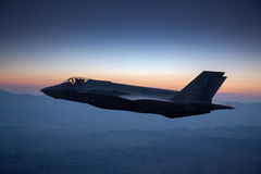 An F-35 Lightning II fighter and other US Air Force jets over NEvada, US. Royalty Free Stock Images