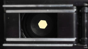 F5.6. A medium aperture setting seen from the inside of an old film camera. Shows the width of the aperature at this setting Stock Photos