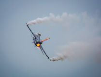 F16 military jet. Belgian F16 military fighter jet with afterburner Stock Photography