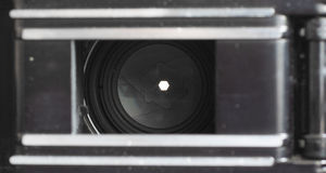 F22. A narrow, aperture setting seen from the inside of an old film camera. Shows the width of the aperature at this setting Royalty Free Stock Photos