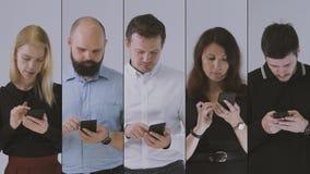 F?nf verschiedene Teammitglieder, welche die Kamera beim L?cheln ?ber ihren Erfolg betrachten stock video footage