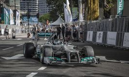 F1 NICO ROSBERG. 2014 March: Nico Rosberg making his f1 demo run in KL city centre, Rosberg Mercedes F1 driver start driving in front of the Petronas Twin Towers Royalty Free Stock Images