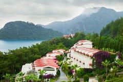 för regnhav för bungalow molnigt väder Royaltyfri Bild