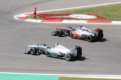 F1 Photo : Cars : Hamilton vs Button - Stock Photo Royalty Free Stock Images