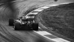 Race car drives hard into the corner royalty free stock image