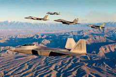 F-22 Raptor flies in formation with other aircraft - F-15, F-16 and A-10. Royalty Free Stock Images