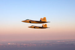 F-22 Raptor flies in formation with other aircraft - F-15, F-16 and A-10. Stock Photos