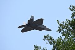 F22 RAPTOR (LOCKHEED-MARTIN) rear view. Defenders of Freedom former Military Aircraft in Action Airshow from Nebraska 2014 Royalty Free Stock Images