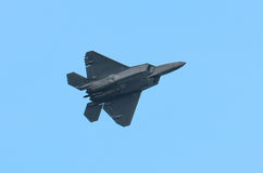 F-22 Raptor. A USAF F-22 Raptor banks and climbs during an aerial demonstration at an airshow Stock Photo