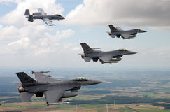 F-16s and A-10s of the United States Air Force fly over the Germany. Royalty Free Stock Images