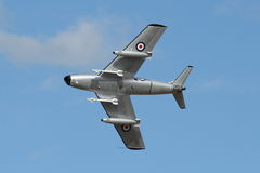 F-86 Sabre showing underside in pass. POINT COOK, AUSTRALIA - FEBRUARY 26: Former post WWII fighter of the RAAF, the F86 Sabre, at air show on February 26, 2012 Stock Image