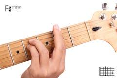 F sharp minor guitar chord tutorial. F#m - basic minor keys guitar tutorial series. Closeup of hand playing F sharp minor chord on guitar, isolated on white Stock Photo