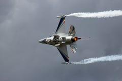 F-16 smoke cloudy Royalty Free Stock Image