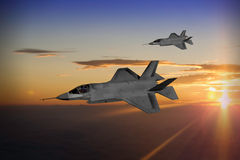F-35 stealth fighter. Modern advanced stealth fighters in formation at sunset or sunrise. (Computer image, artist's impression Stock Images