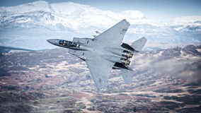 F15 Strike Eagle fighter jet. United States Air Force, USAF F15 Strike Eagle fighter jet over Snowdonia, Wales, UK Royalty Free Stock Photo