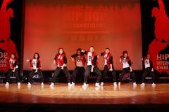 F-team dans bij de Internationale Kop van Hip Hop Stock Fotografie