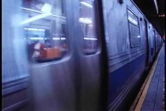 F train pulling out of New York City subway station stock footage