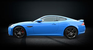 F type Jaguar. A blue F type Jaguar luxury sports saloon with alloy wheels , dark background Royalty Free Stock Photography