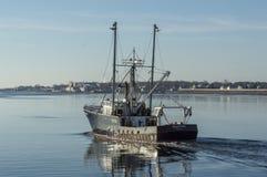 F/V Edgartown leaving port. New Bedford, Massachusetts, USA - February 19, 2018: Commercial fishing vessel Edgartown heading for Buzzards Bay on calm morning Stock Photo
