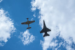 F-16 Viper and P-51C. American fighter jet flying alongside P-51C in a historic memorial flyby Royalty Free Stock Photos