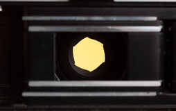 F2.8. A wide, fast aperture setting seen from the inside of an old film camera. Shows the width of the aperature at this setting Royalty Free Stock Photos