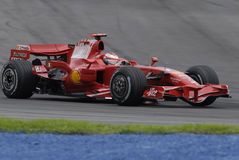 F1. Kimi Raikkonen negotiating a turn at Sepang F1 Malaysia 200 Grand Prix Royalty Free Stock Photos