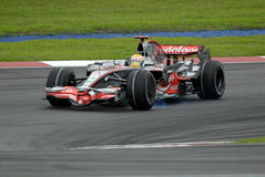 F1. Lewis Hamilton breaks while make a turn at Sepang F1 Malaysia 2008 Grand Prix Royalty Free Stock Images